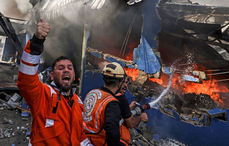 Palestinian firefighters douse a fire in Gaza.