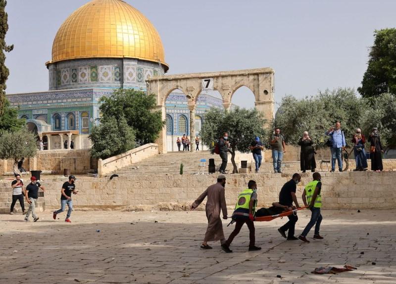 Palestinian medics walk near the Dome of the Rock.