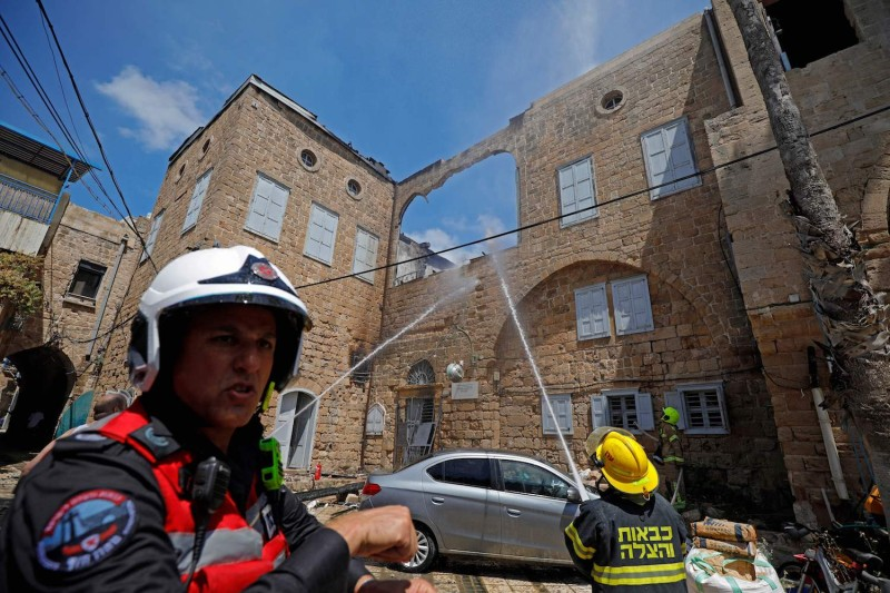 Firefighters extinguish fire in Acre, Israel.