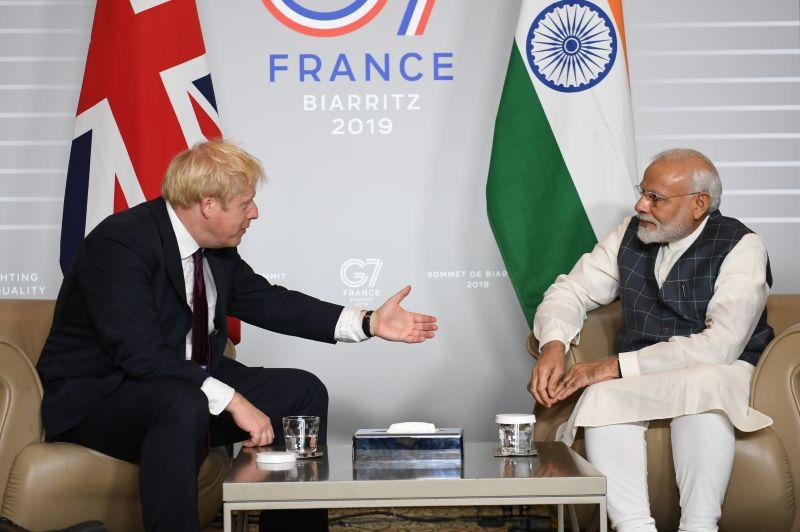 British Prime Minister Boris Johnson meets Indian Prime Minister Narendra Modi during the G-7 summit in Biarritz, France, on Aug. 25, 2019.