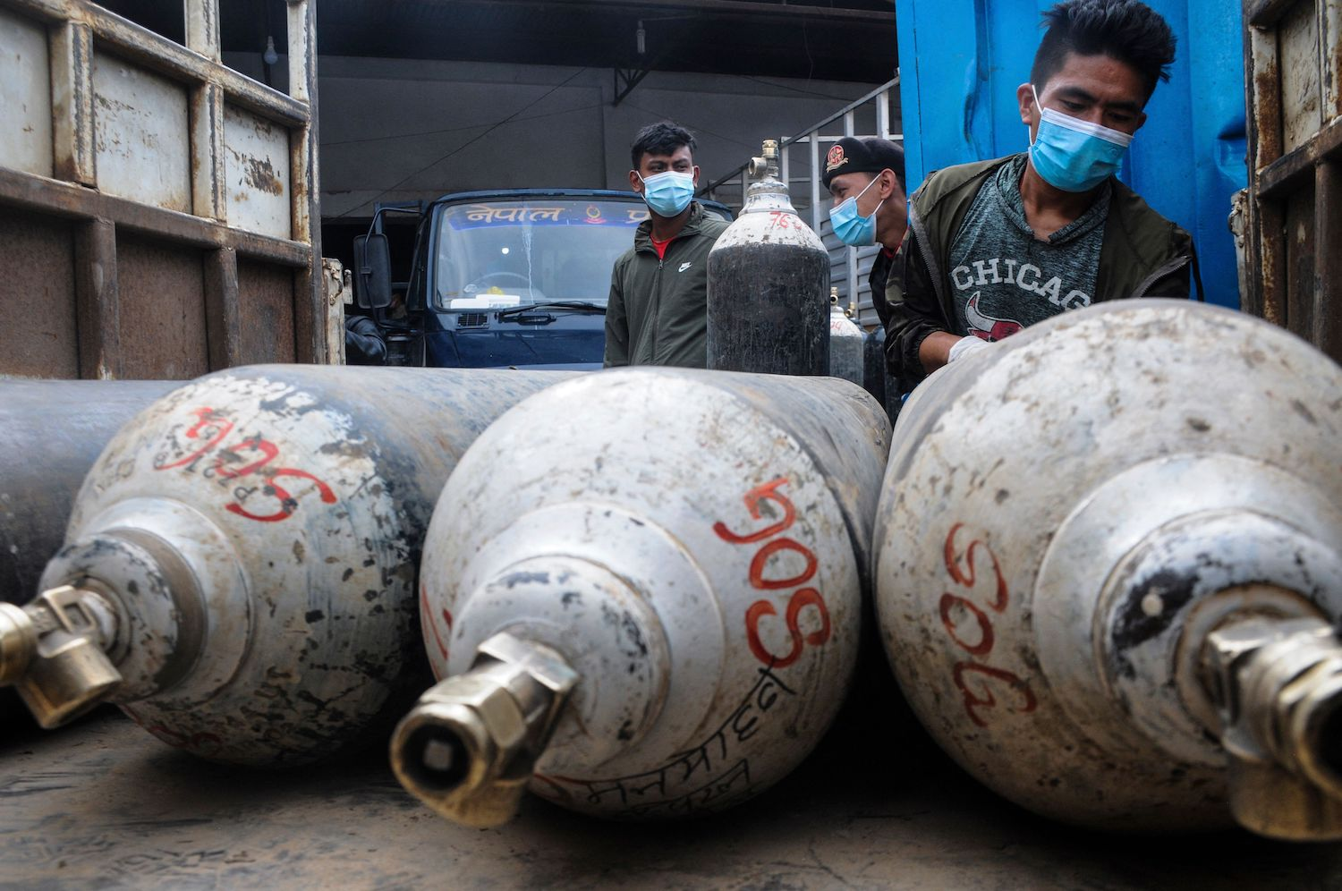 A man loads cylinders with medical oxygen for coronavirus patients in Kathmandu, Nepal, on May 13.