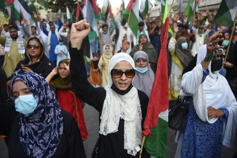 Protesters carry Palestinian flags in Pakistan.