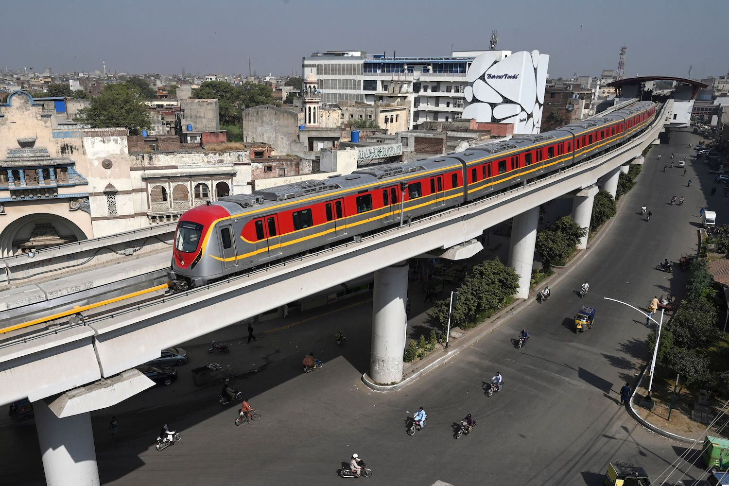 A newly built metro train, a project planned under the China-Pakistan Economic Corridor (CPEC), drives through on a track in Lahore, Pakistan, on Oct. 26, 2020.