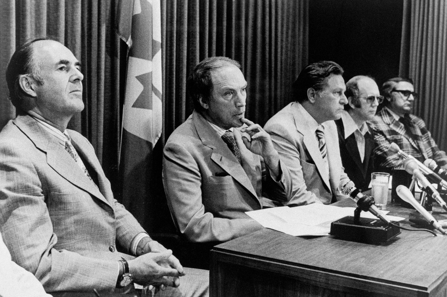 Pierre Trudeau sits with his ministers to announce Canada would begin negotiations with the United States to build an Arctic pipeline in 1977.