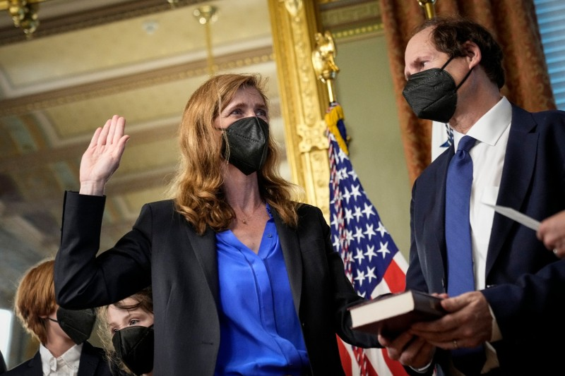 Samantha Power is sworn in as administrator of the U.S. Agency for International Development with her husband, Cass Sunstein, at the White House on May 3.