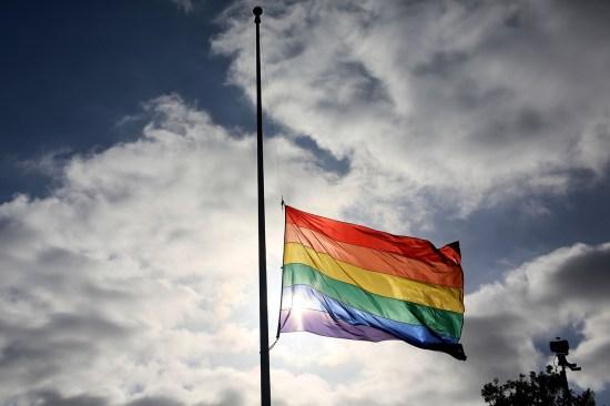 Gay pride flag at half-staff