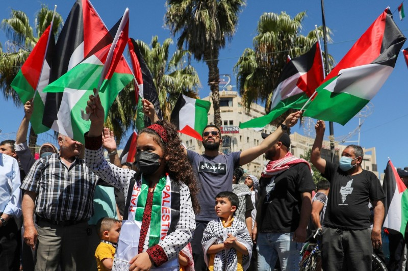 Palestinians demonstrate in solidarity with Gaza in Ramallah, in the occupied West Bank, on May 18.