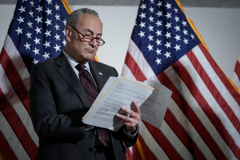 Senate Majority Leader Chuck Schumer looks over notes before speaking during a news conference about the Endless Frontier Act in Washington on May 18.