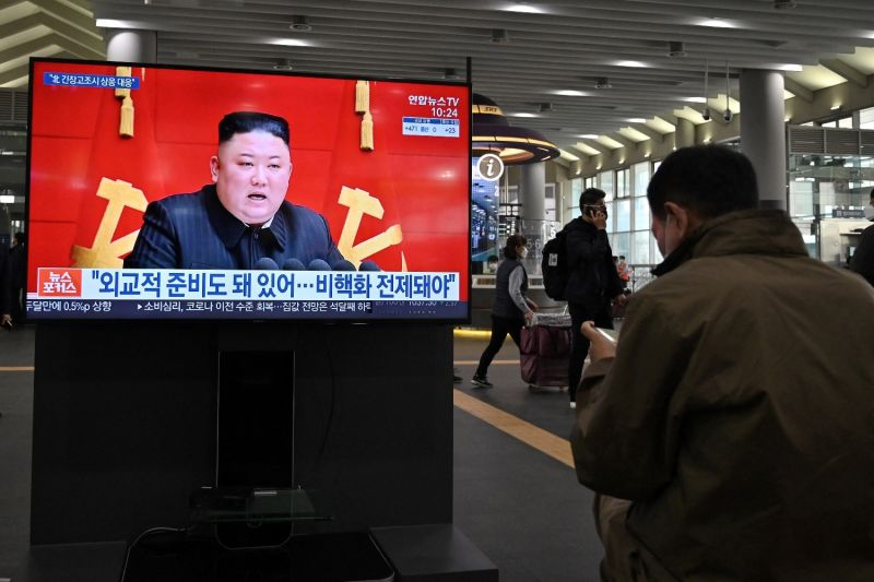 People watch a television screen showing North Korean leader Kim Jong Un.