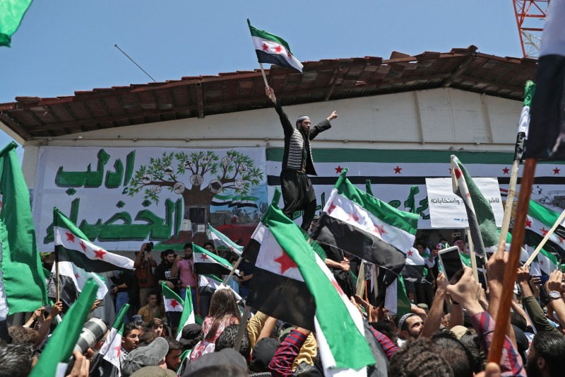 Syrians demonstrate against what they call illegitimate elections in the opposition-held city of Idlib, Syria, on May 26.
