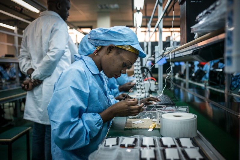 A woman works at a phone factory in the Republic of Congo.