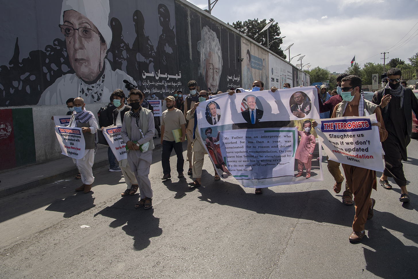 Interpreters march in a demonstration in Kabul on June 25.