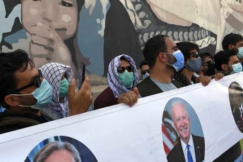 Interpreters demonstrate for U.S. visas.