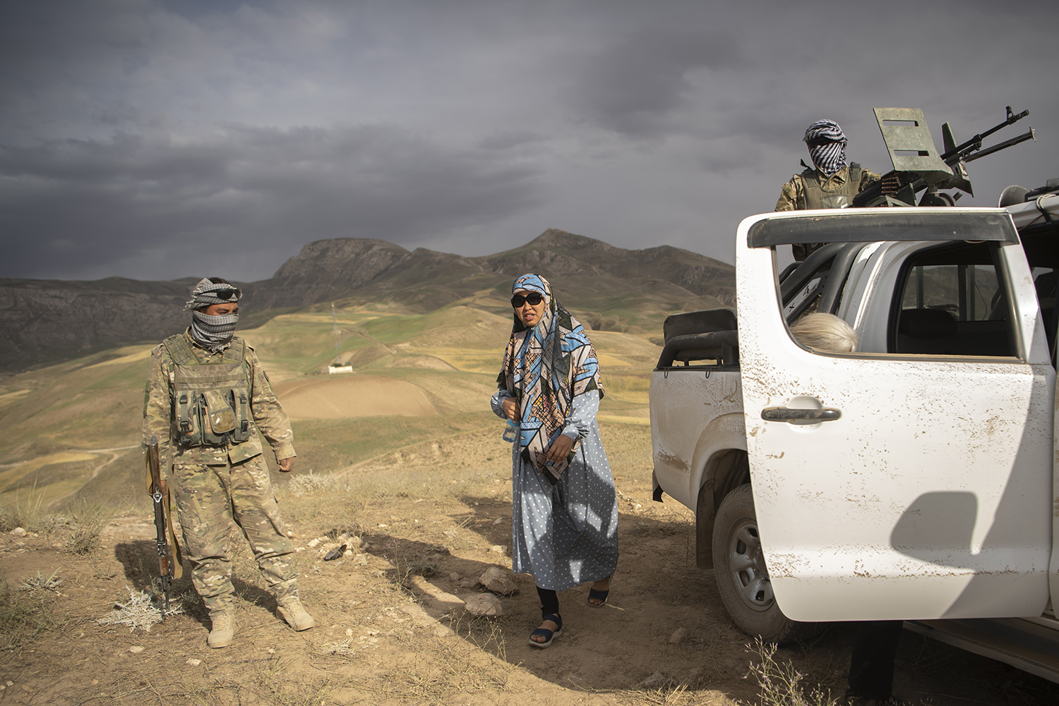 Mazari checks in with the local militia in the Charkint District on June 29.