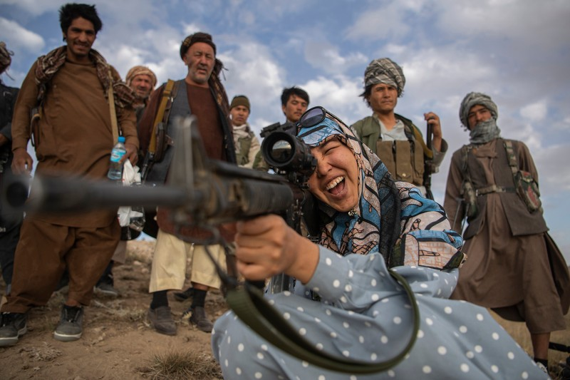 Charkint District Governor Salima Mazari points a gun as she visits  forces in Charkint district of Balkh province on June 29.