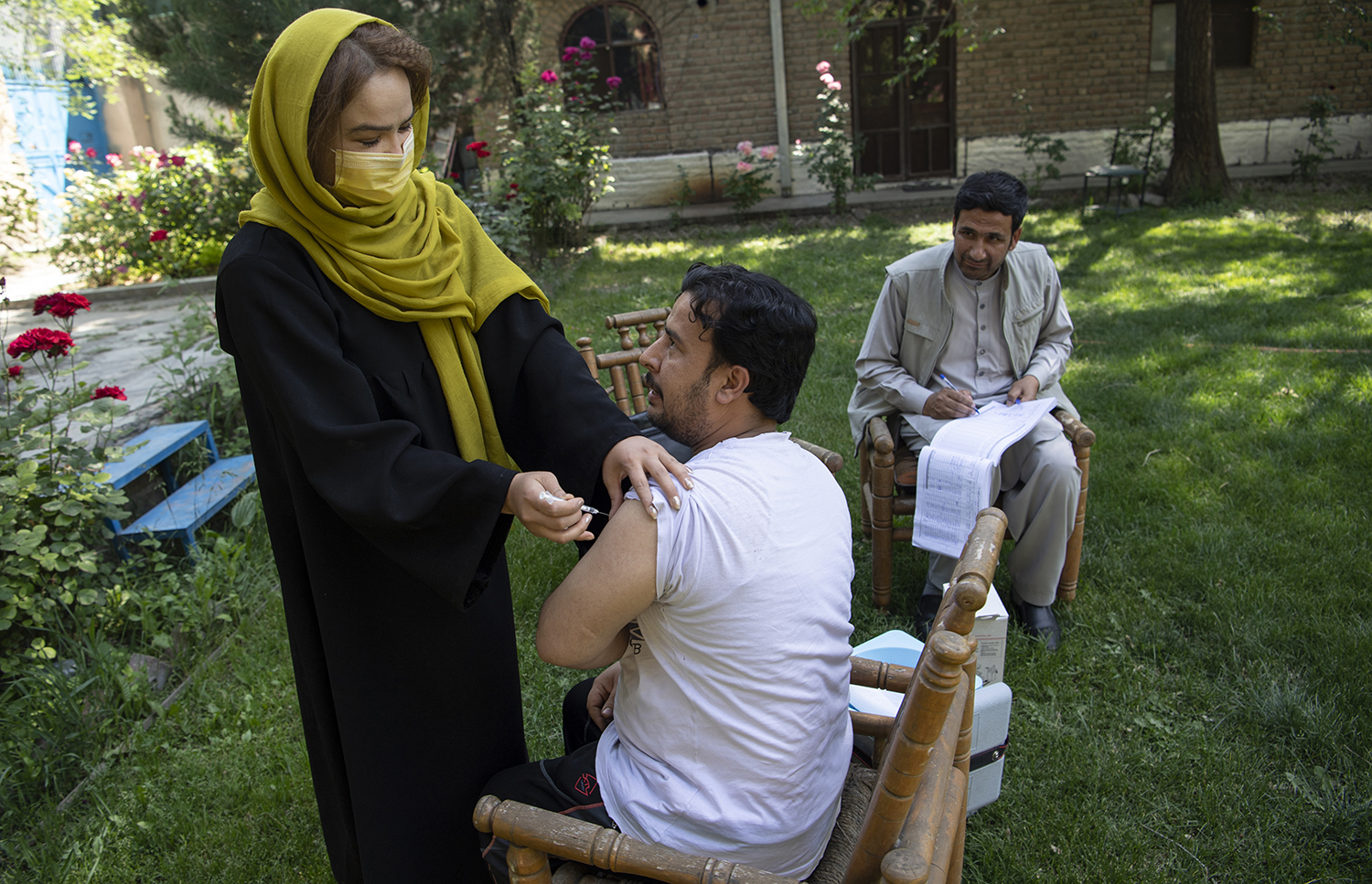 A local gardener receives his first round of vaccination from an employee of Sanayee Development Organisation, in Kanul, Afghanistan, on May 25.