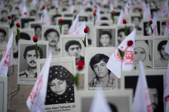 Portraits of victims and flags