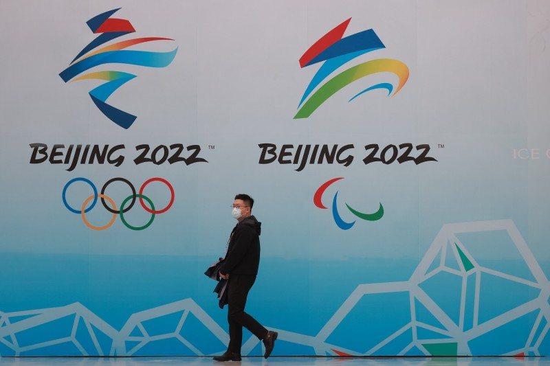 A Chinese man walks in front of the National Aquatics Center in Beijing.