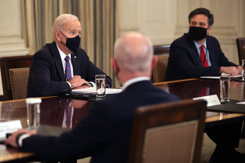 U.S. President Joe Biden meets with officials at the White House to discuss migration issues.