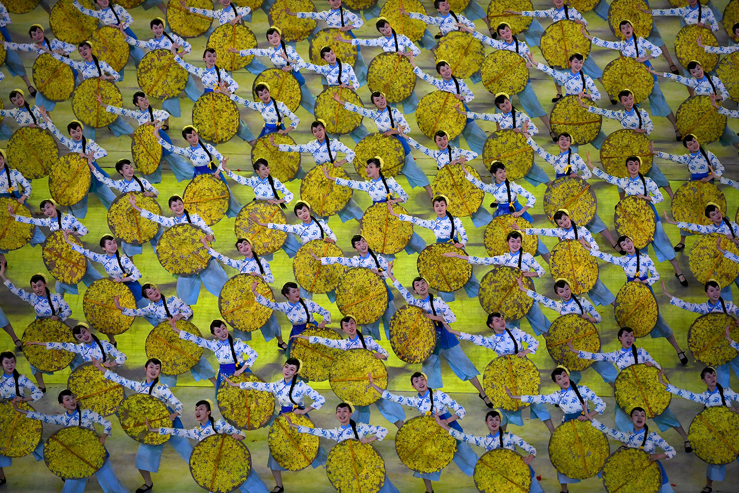 Women dance to mark China's 100th founding of Communist Party