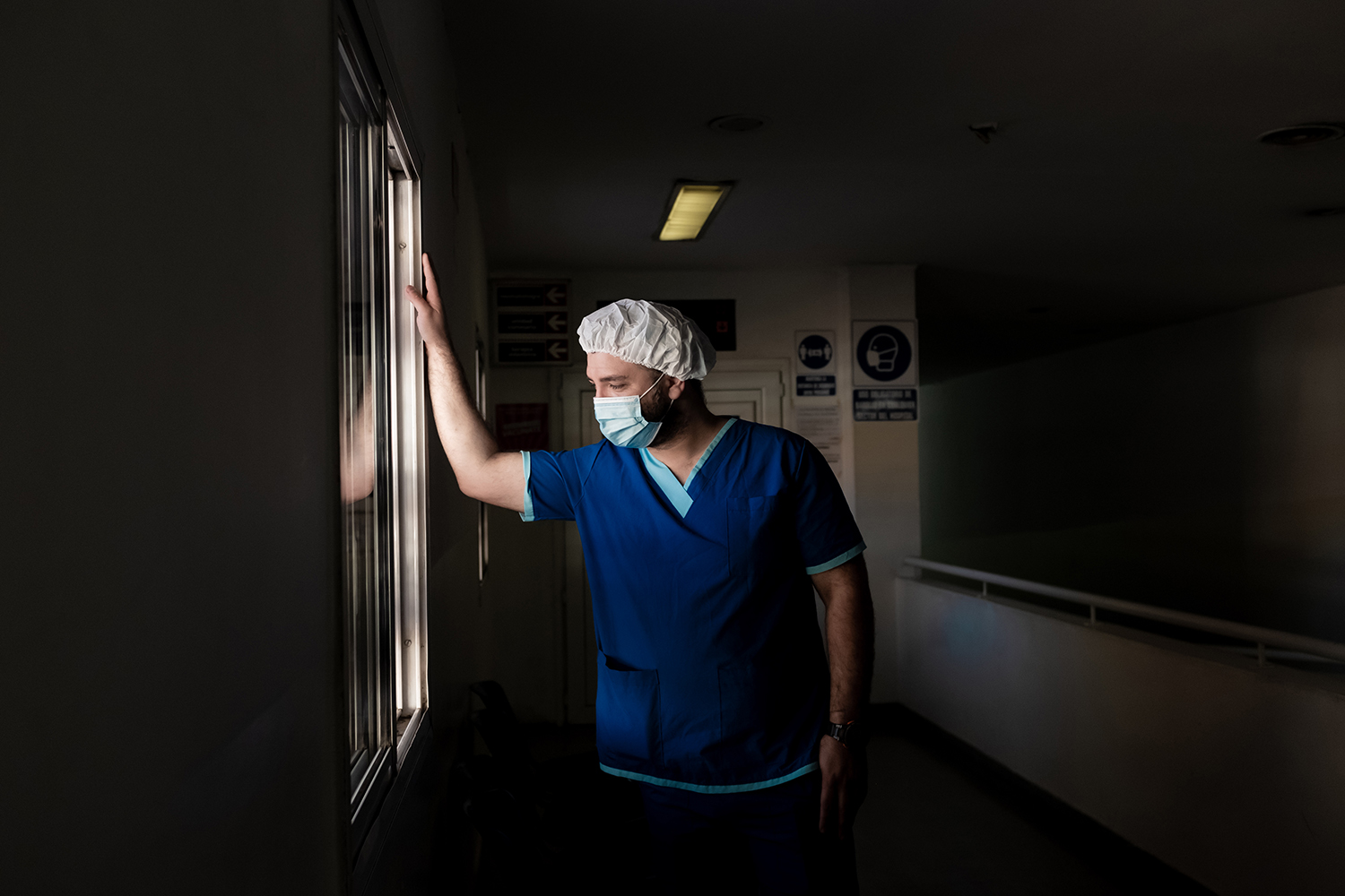 Damián Leyes, the supervisor of the morning shift at Mariano y Luciano de la Vega, stands in the hallway of the hospital on May 7.