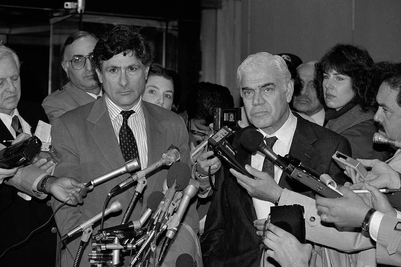 Edward Said, left, and Ibrahim Abu-Lughod speak to reporters