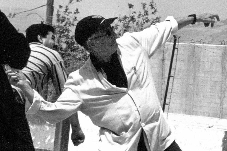 Edward Said throws a stone toward Israeli soldiers