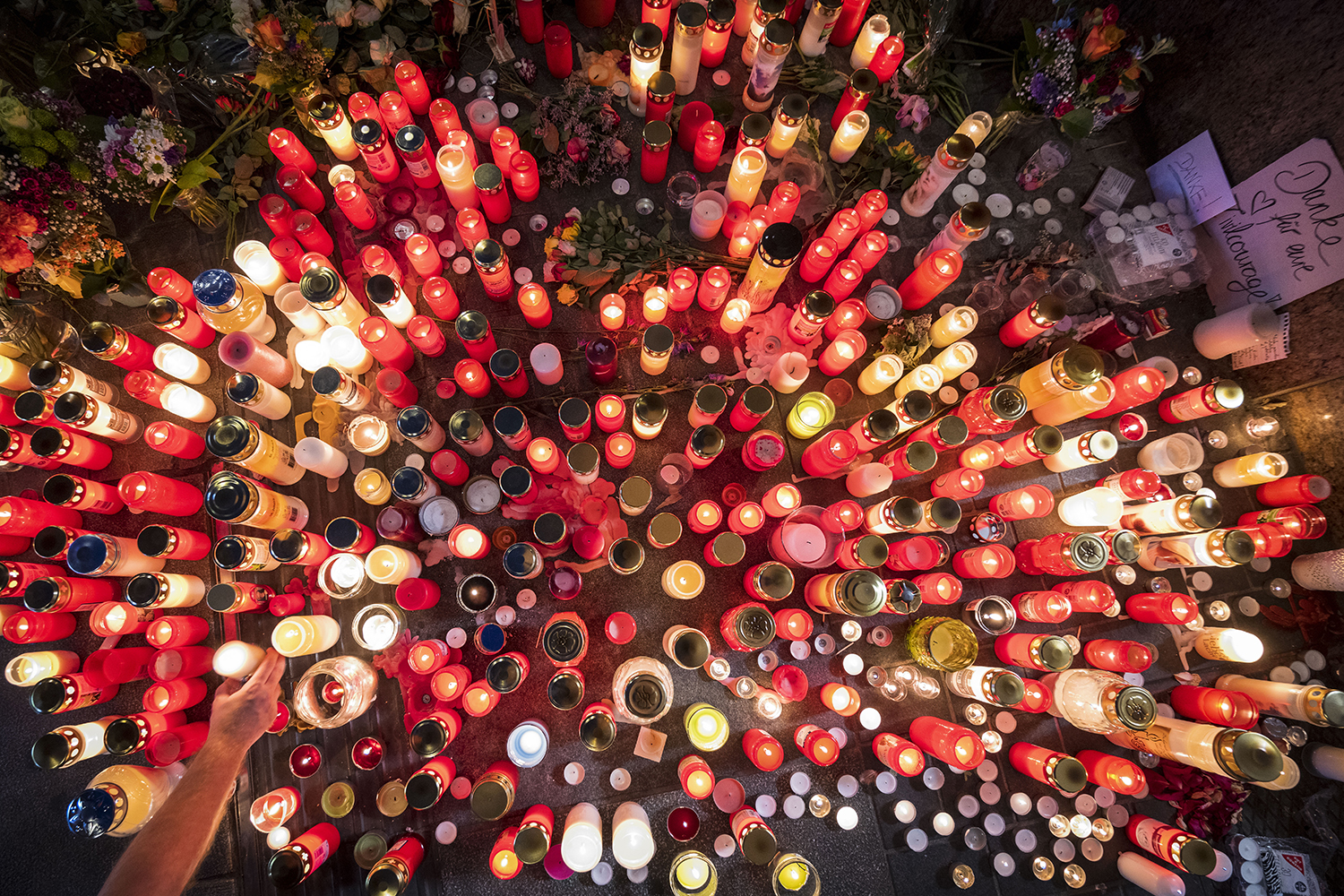 Candles lit after fatal attack in Germany
