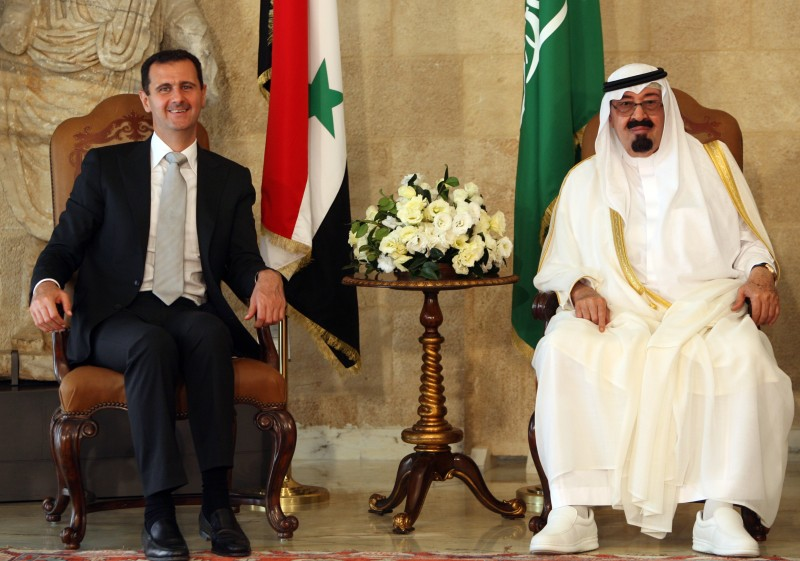 Syrian President Bashar al-Assad sits along side Saudi Arabia's King Abdullah at the Presidential Palace in Baabda, east of Beirut, on July 30, 2010.
