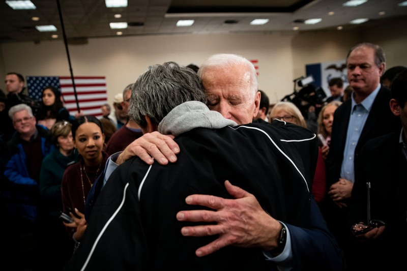 Joe Biden hugs an attendee.
