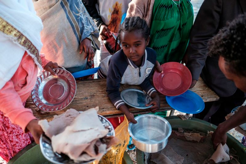 A displaced child from western Tigray waits to receive a plate of food in Mekele, Tigray.