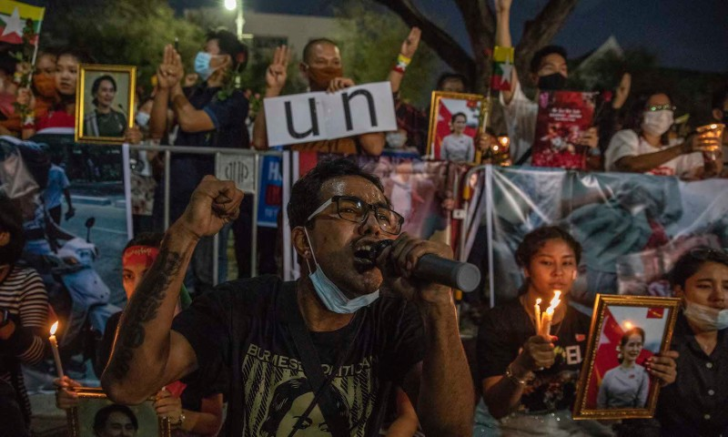 Myanmar nationals hold a vigil in Thailand