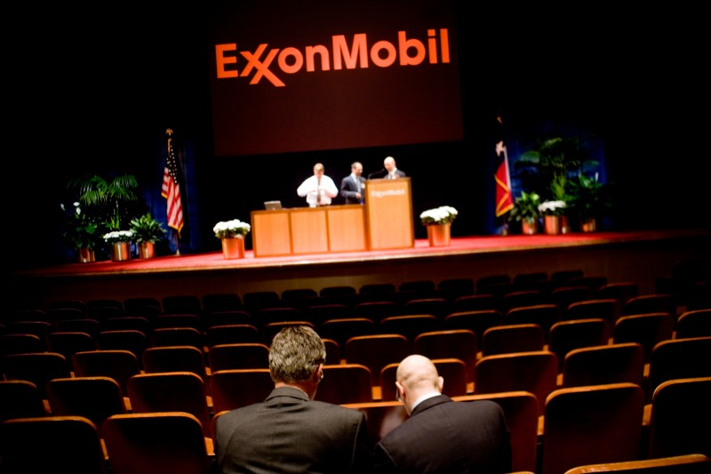 Two men talk after the end of the ExxonMobil annual shareholders meeting on May 28, 2008 in Dallas, Texas.