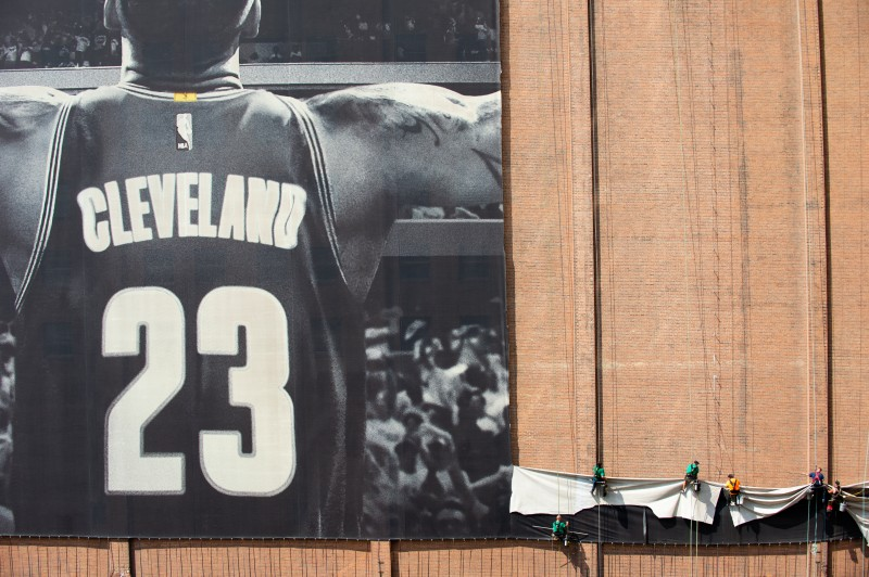 Workers take down the LeBron James banner.