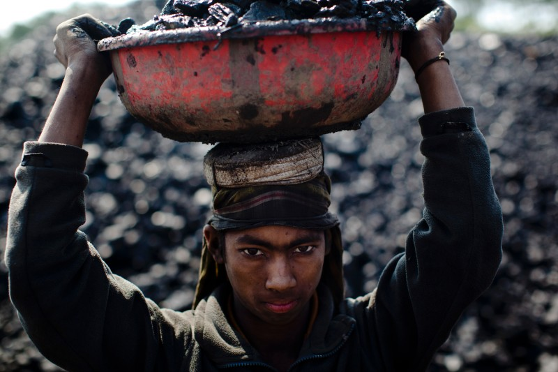 A 12-year-old worker carries coal in the district of Jaintia Hills, India, on April 15, 2001.