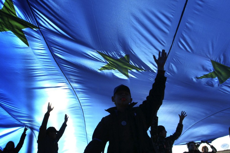 Young supporters of Belarus's opposition carry a European Union flag at a rally in Minsk on Oct. 14, 2007.
