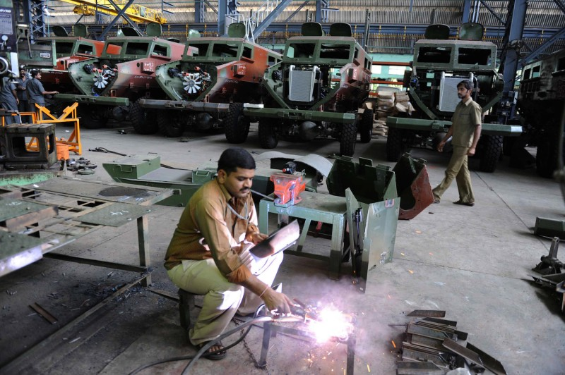 A man works at an Indian ordnance factory.