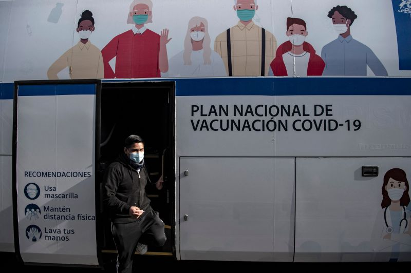 A man gets off a bus used as a vaccination center after being inoculated against COVID-19 in Santiago on June 22.