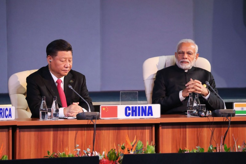 Chinese President Xi Jinping and Indian Prime Minister Narendra Modi attend a session meeting during the 10th BRICS summit in Johannesburg on July 27, 2018.