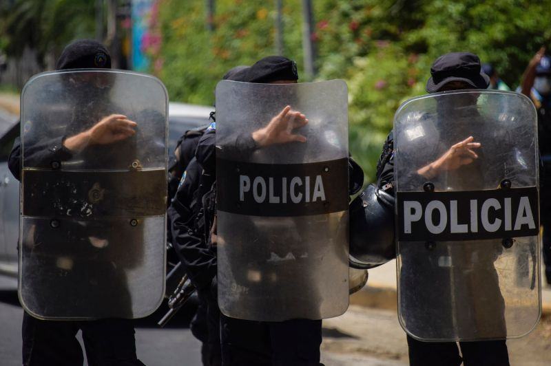 Riot police stand guard outside the house of Cristiana Chamorro, a presidential candidate who was arrested this week, in Managua, Nicaragua, on June 2.