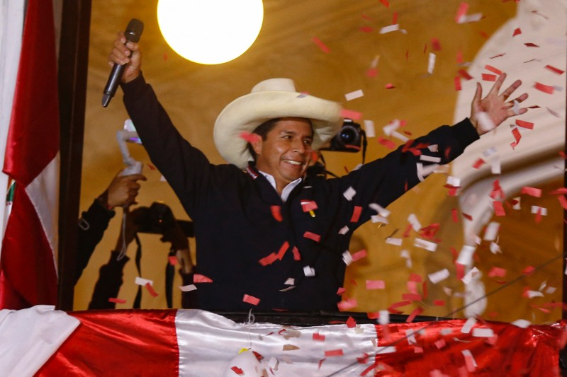 Peruvian leftist presidential candidate Pedro Castillo of Peru Libre waves to supporters from his party headquarters balcony in Lima on June 8.