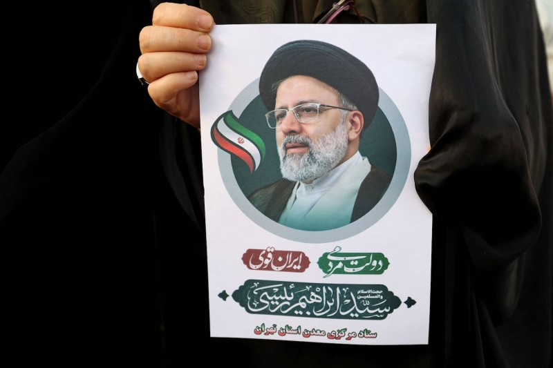 Supporters of Iranian presidential candidate Ebrahim Raisi hold posters as they attend an election campaign rally in Tehran, Iran, on June 14.