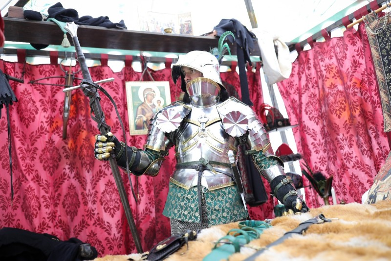 A man dressed as a knight checks a sword during the annual Ritterfest at Satzvey Castle in Mechernich, Germany.on September 5, 2020.