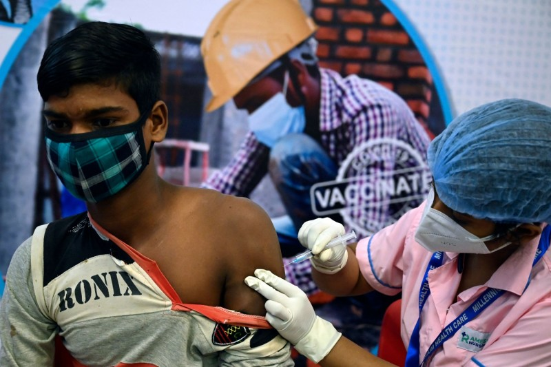 A health worker administers a COVID-19 vaccine in India.