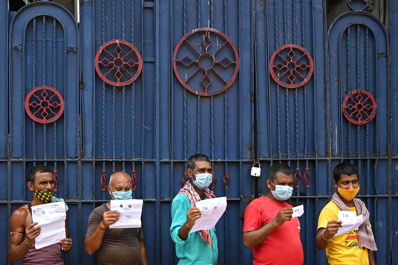 Men line up for Covishield vaccine in India