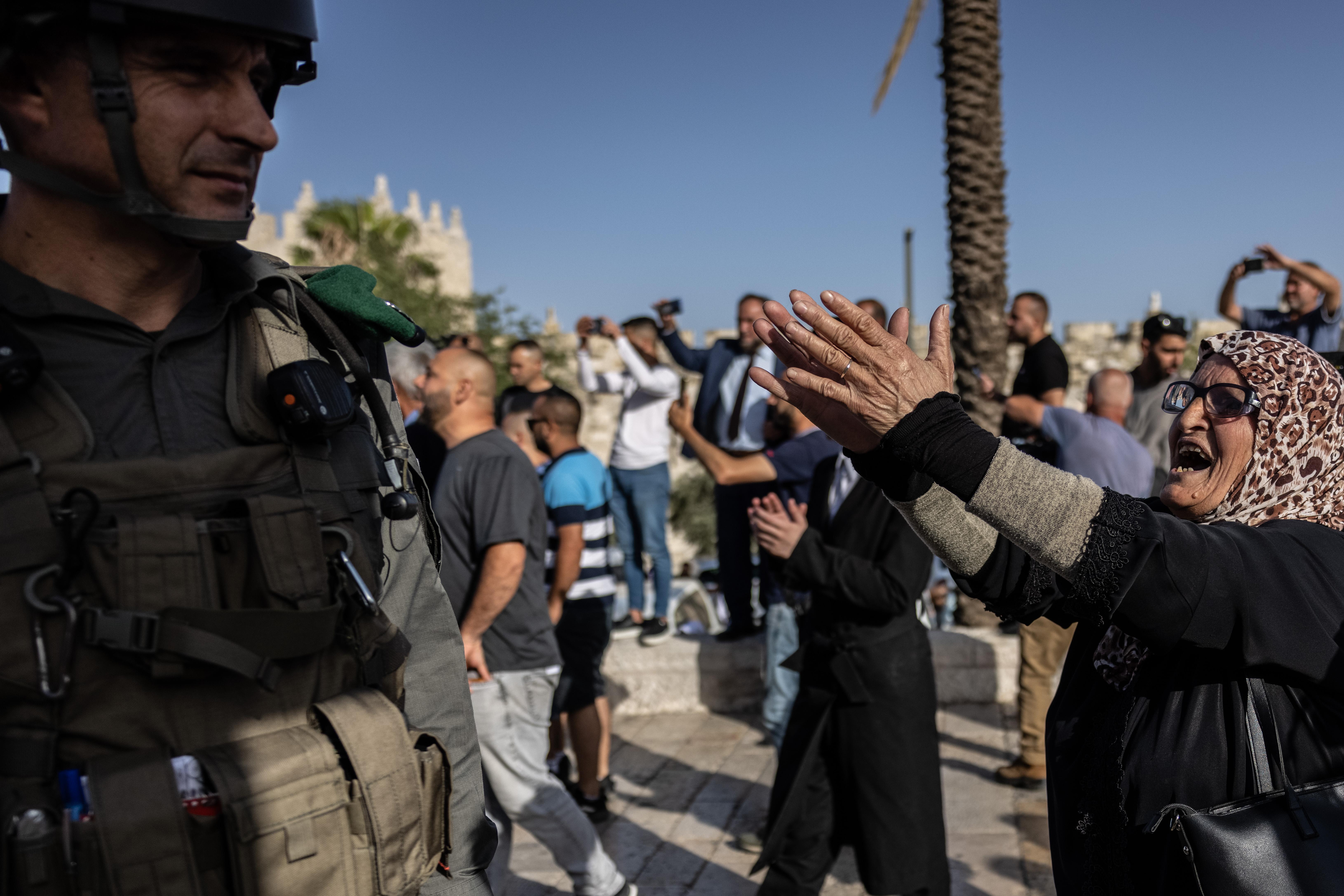 A Palestinian activist confronts a soldier in Jerusalem.