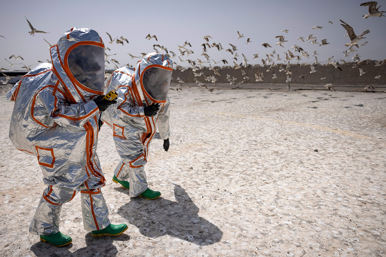 Moroccan military members wear biochemical suits