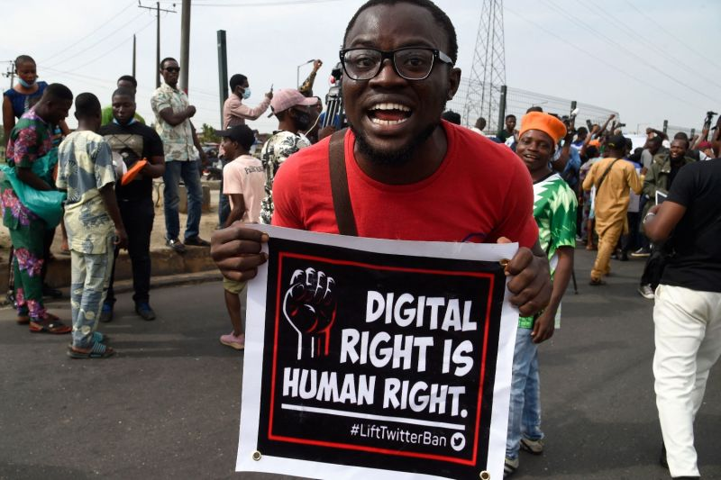 A man carries a banner during a demonstration in Ojota in Lagos, Nigeria on June 12, 2021.