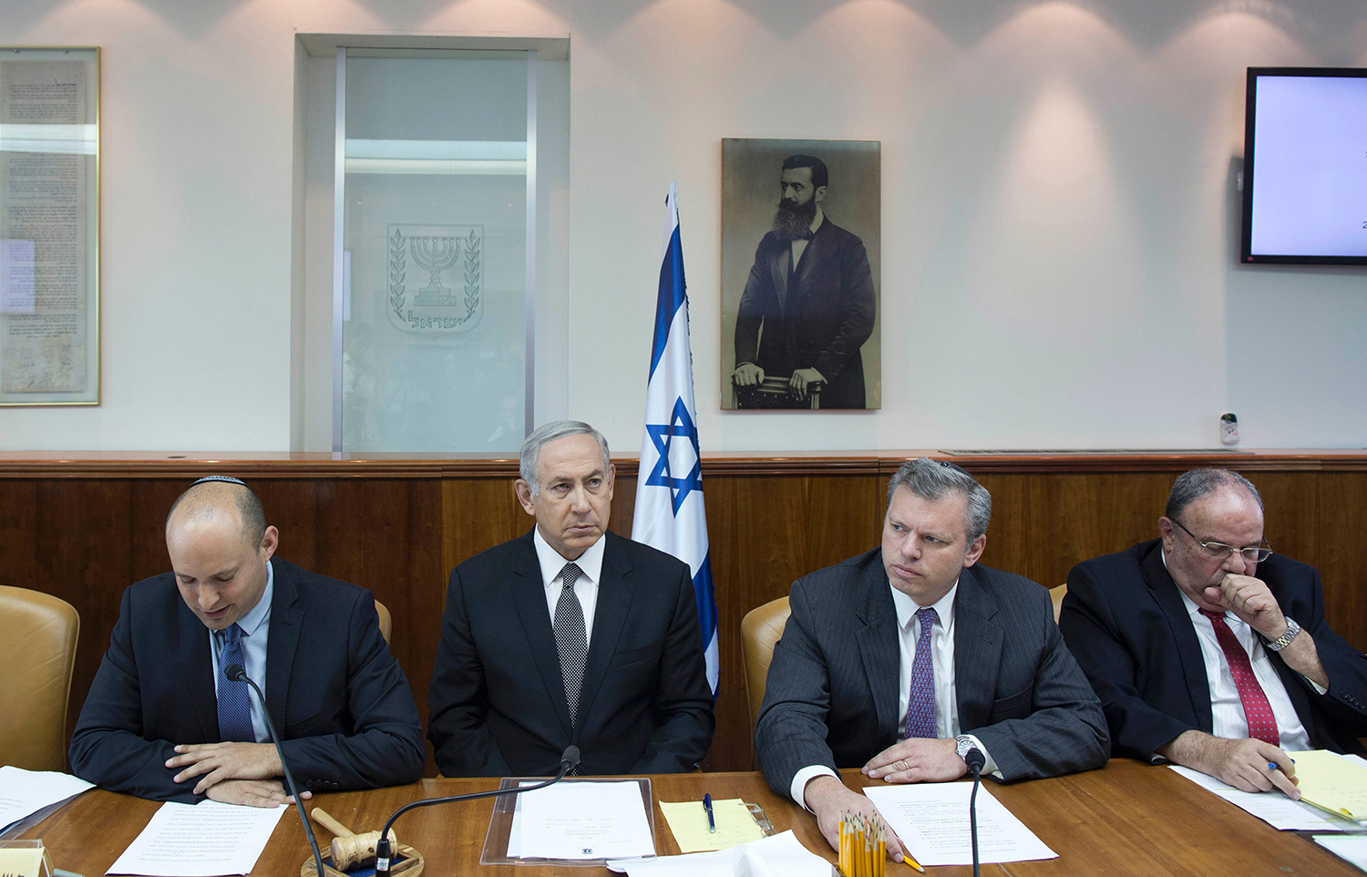Israeli Prime Minister Benjamin Netanyahu listens to Bennett, then education minister, during the weekly cabinet meeting in Jerusalem on Aug. 30, 2016. ABIR SULTAN/AFP via Getty Images