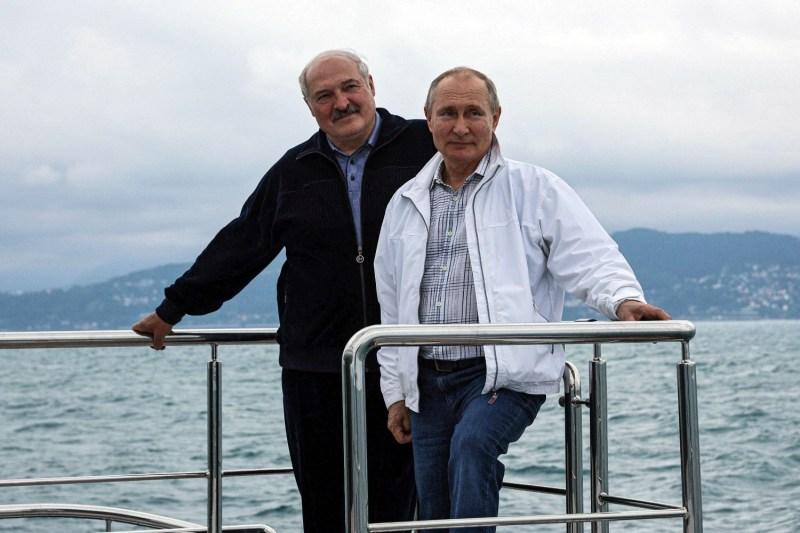 Russian President Vladimir Putin and Belarusian strongman Aleksandr Lukashenko pose on a boat.